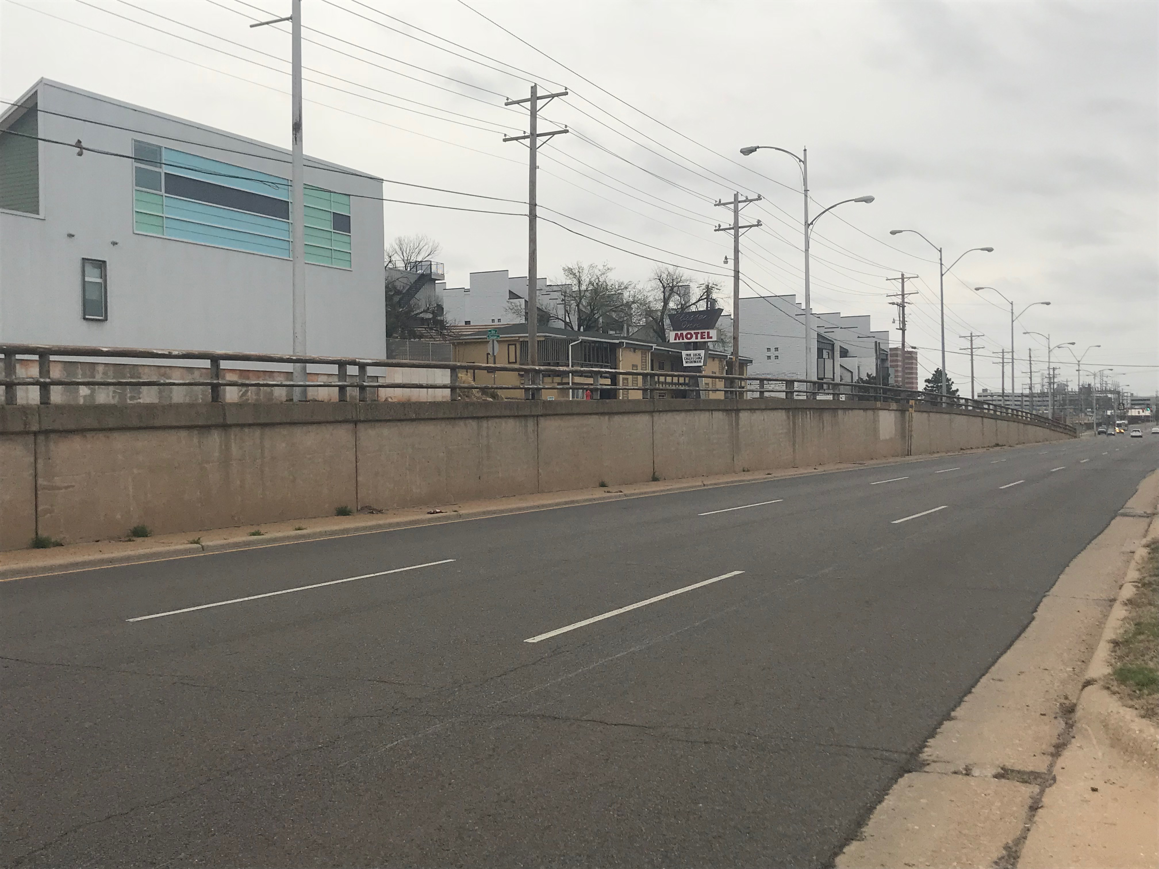 West side of Classen Blvd, divider between NW 9TH and 7TH streets