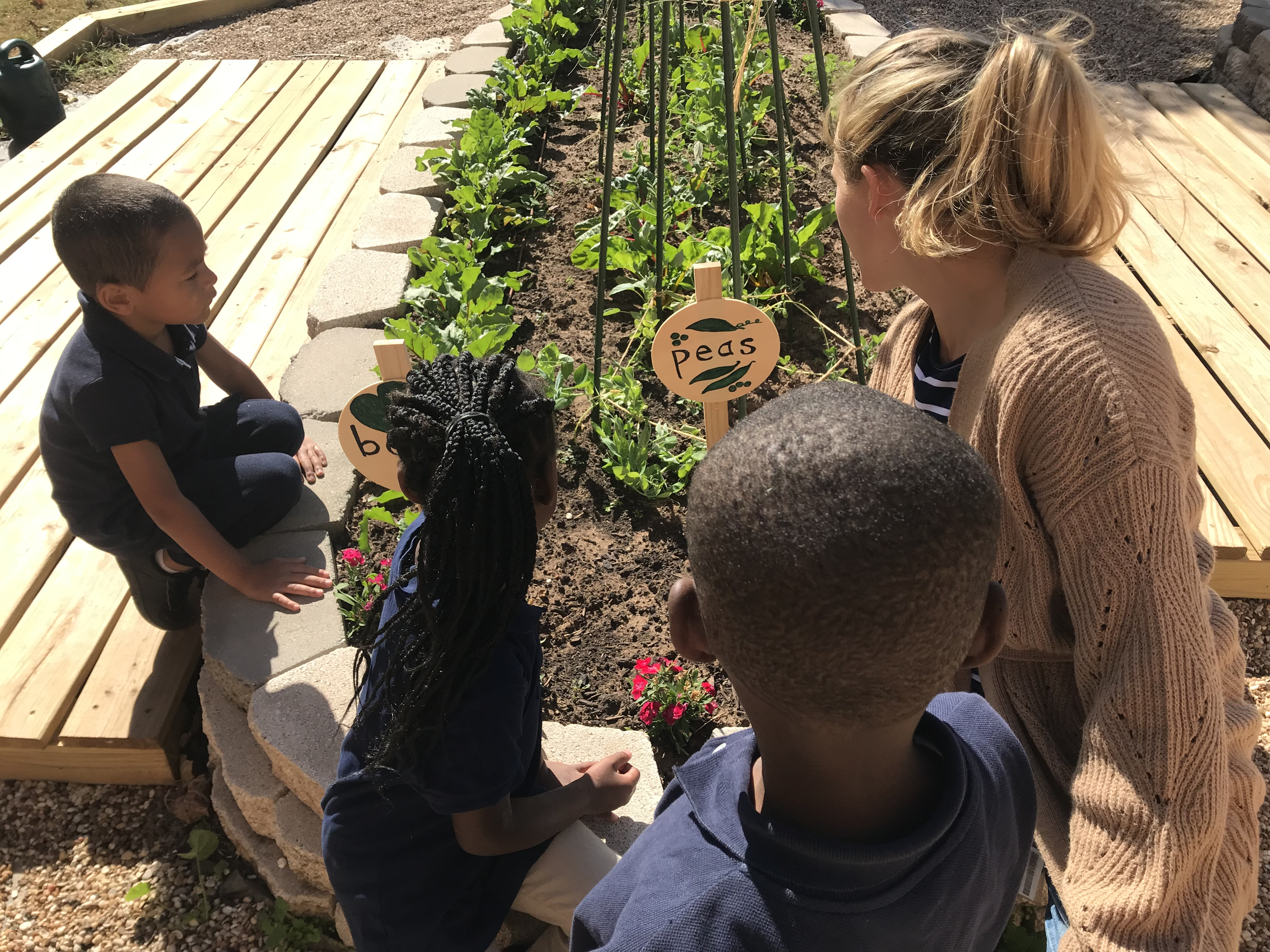 Garden Educator, Micah Stover, practices letter sounds with Kindergarten students at Bodine Elementary School